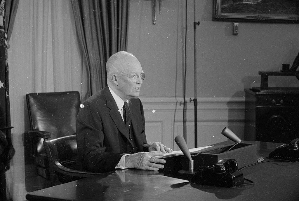 Dwight D. Eisenhower sitting at his desk