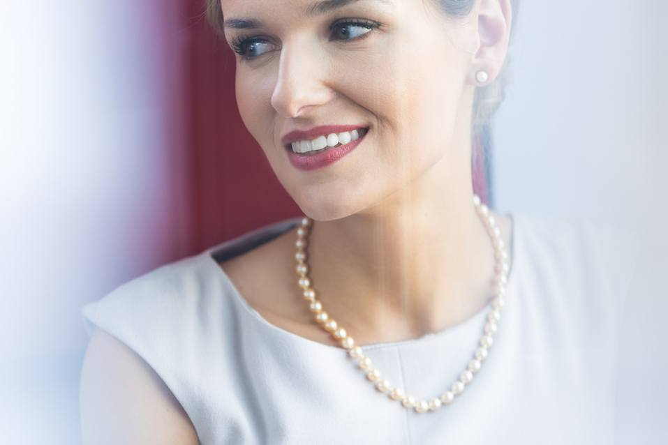 Elegant woman wearing pearl jewelry