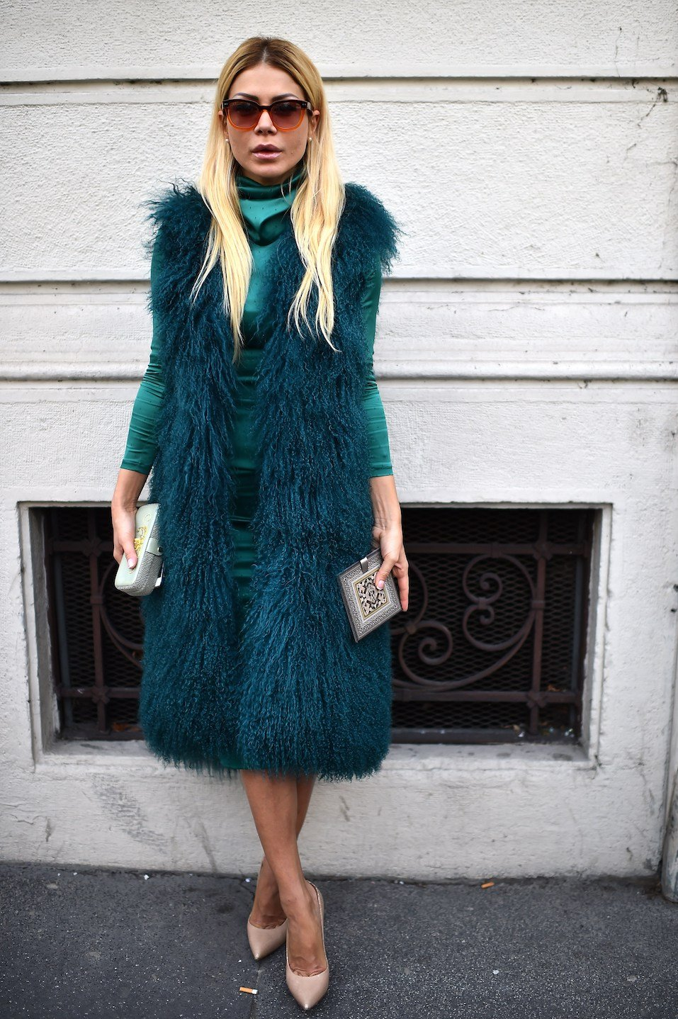 A woman poses in the street before the Etro show