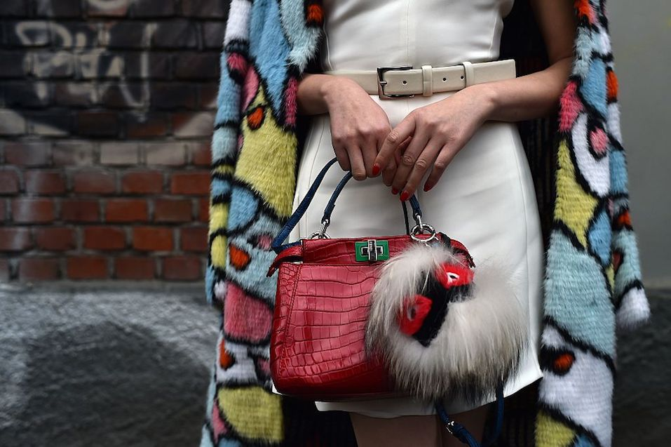 A woman poses in the Milan's Fashion Week