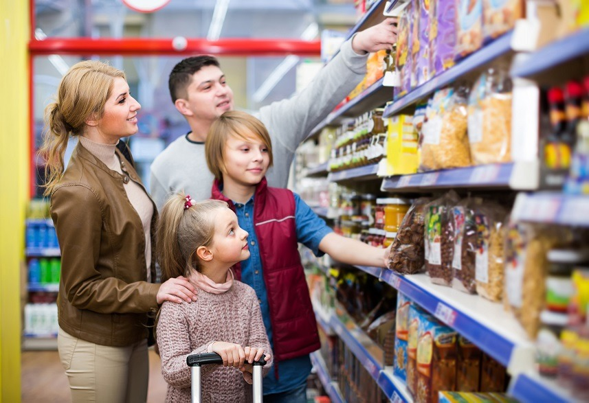 Family with children standing in supermarket