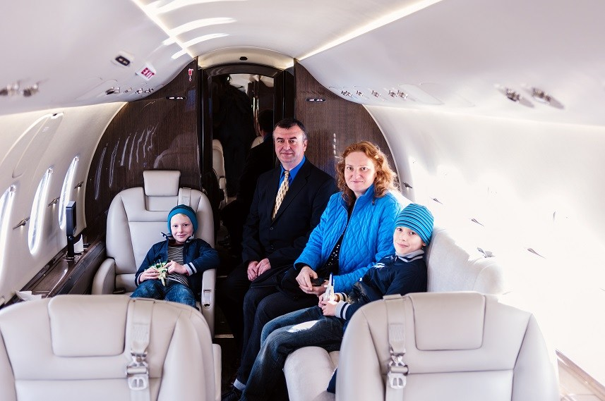Family traveling by commercial air jet