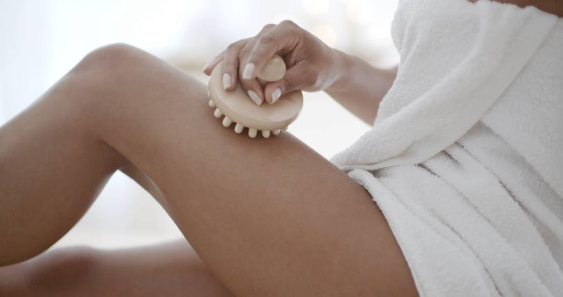 Female thigh massage with massage brush