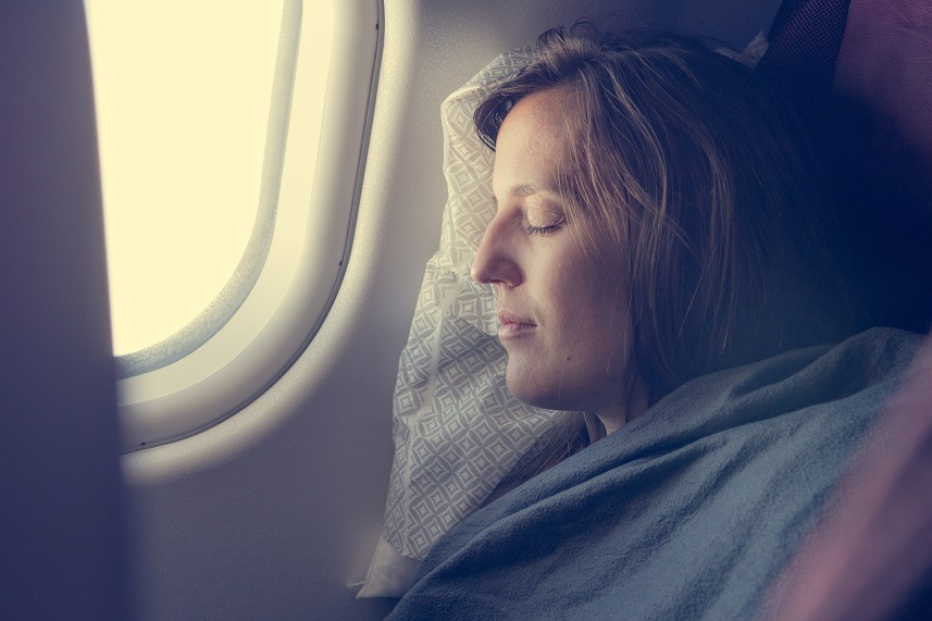 passenger sleeping covered with blanket