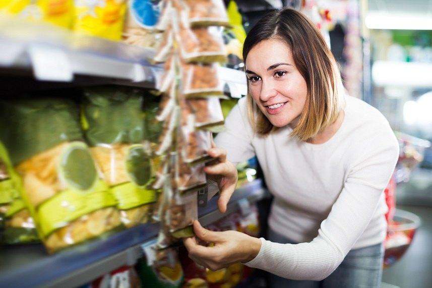 Female shopper searching for snacks