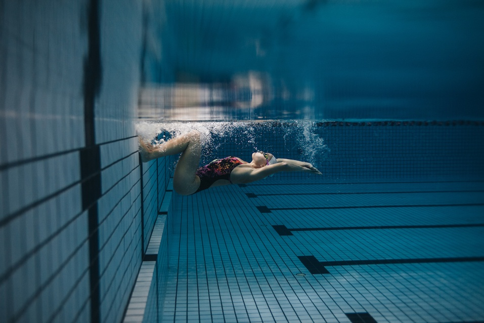 Swimmer in action inside swimming pool