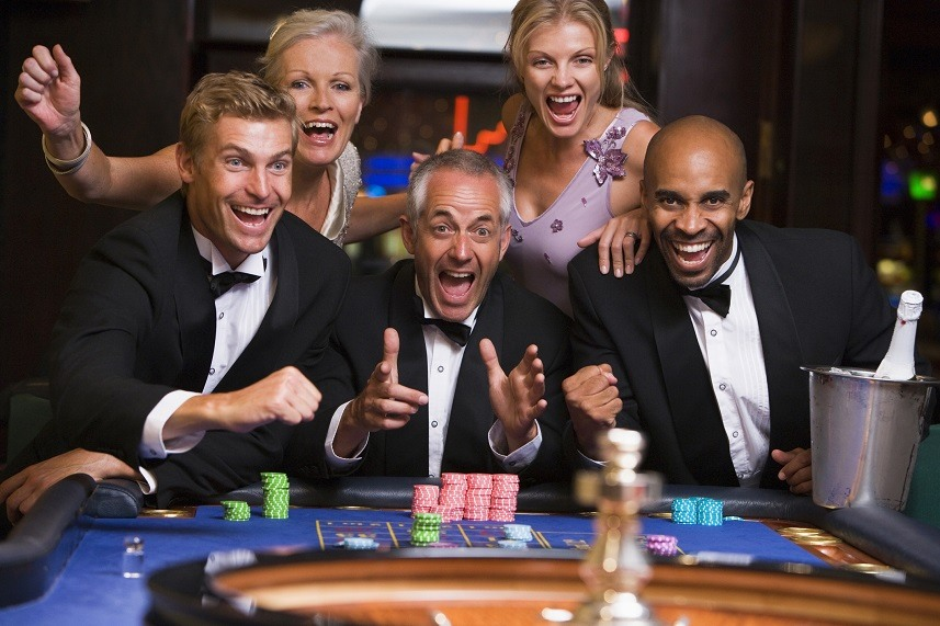 Five people in casino playing