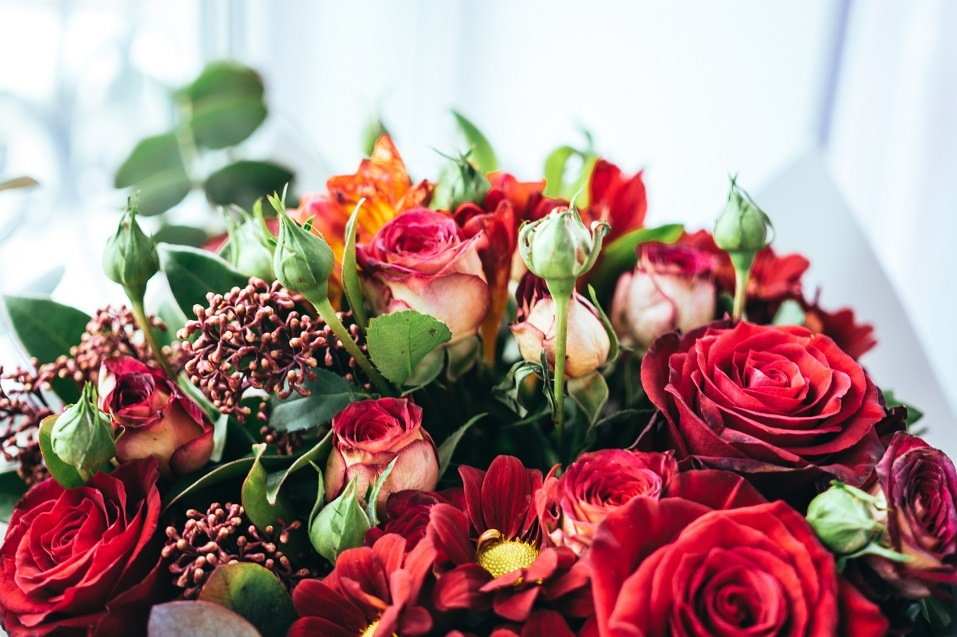 Red roses and other flowers