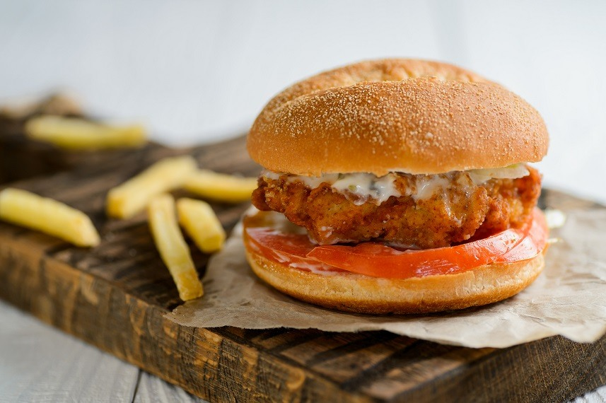 Chicken burger on wooden table