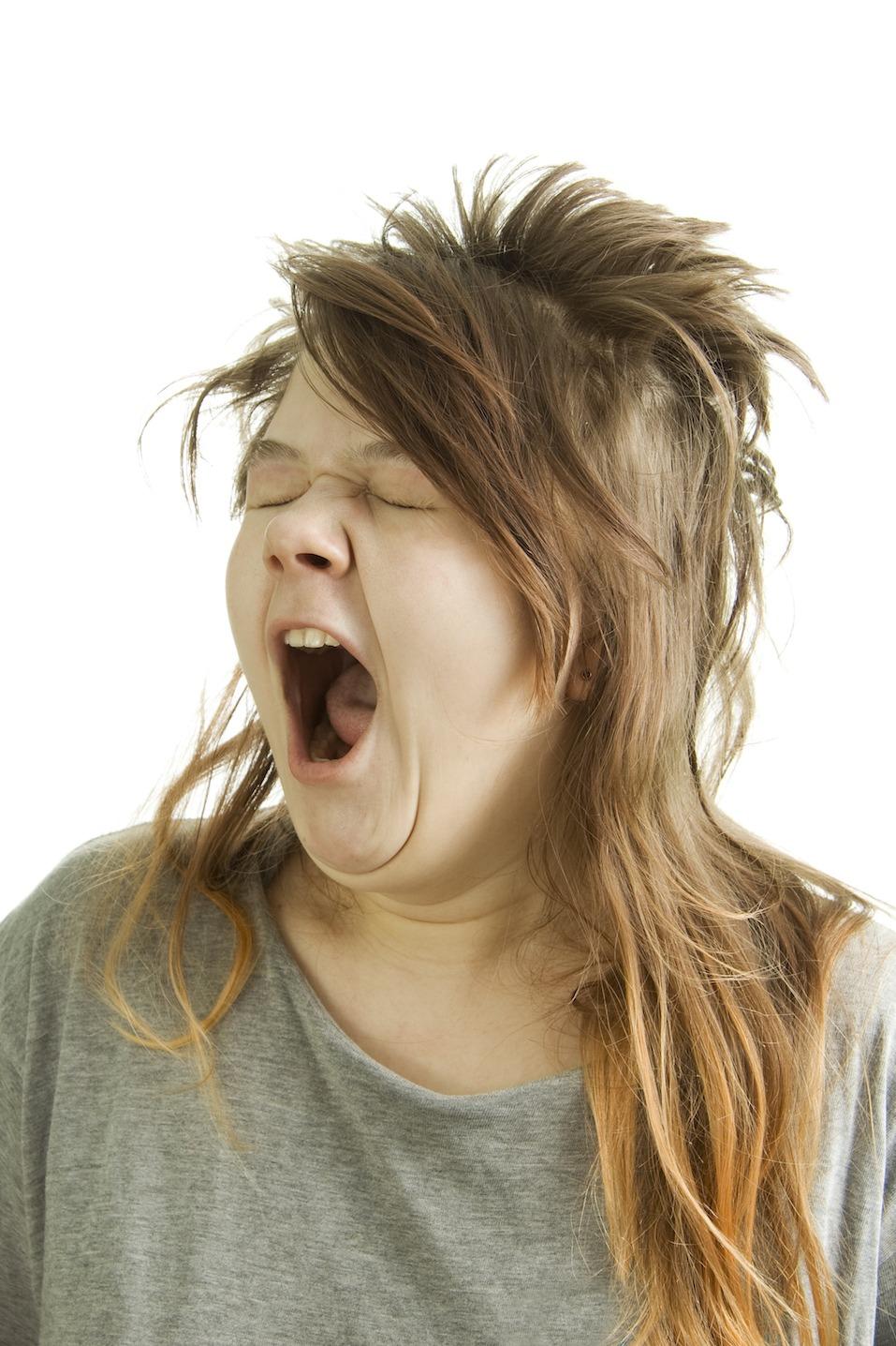 Sleepy girl yawning