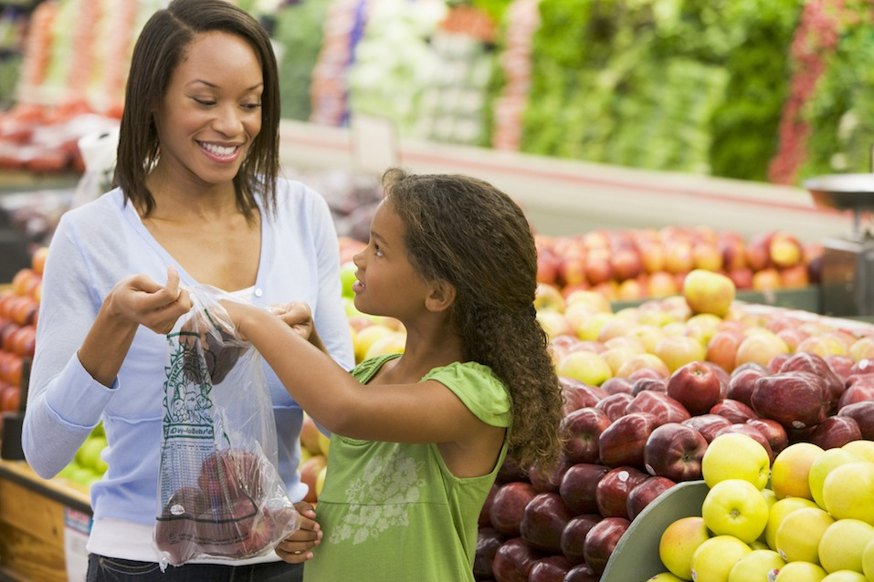 mom and daughter shopping for produce