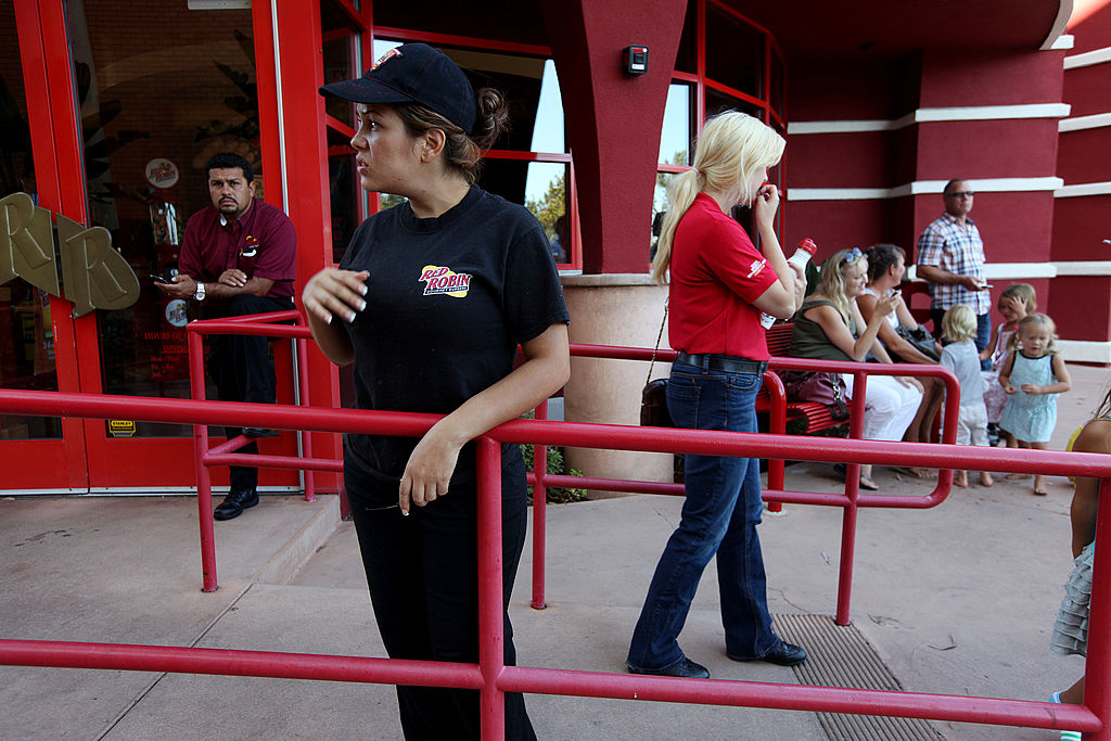 Workers stand outside of a Red Robin Restaurant