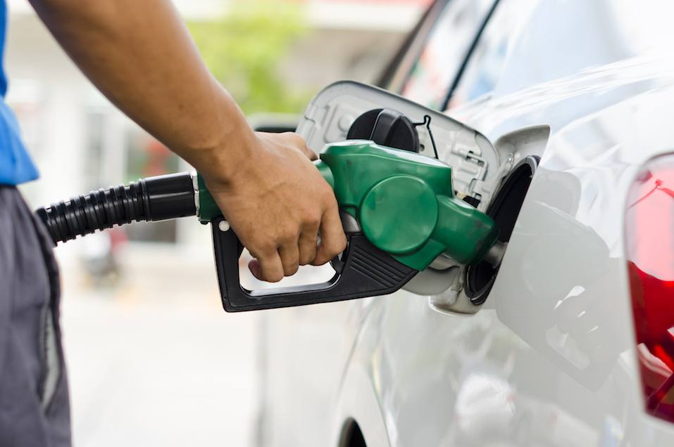 person filling up car with gas