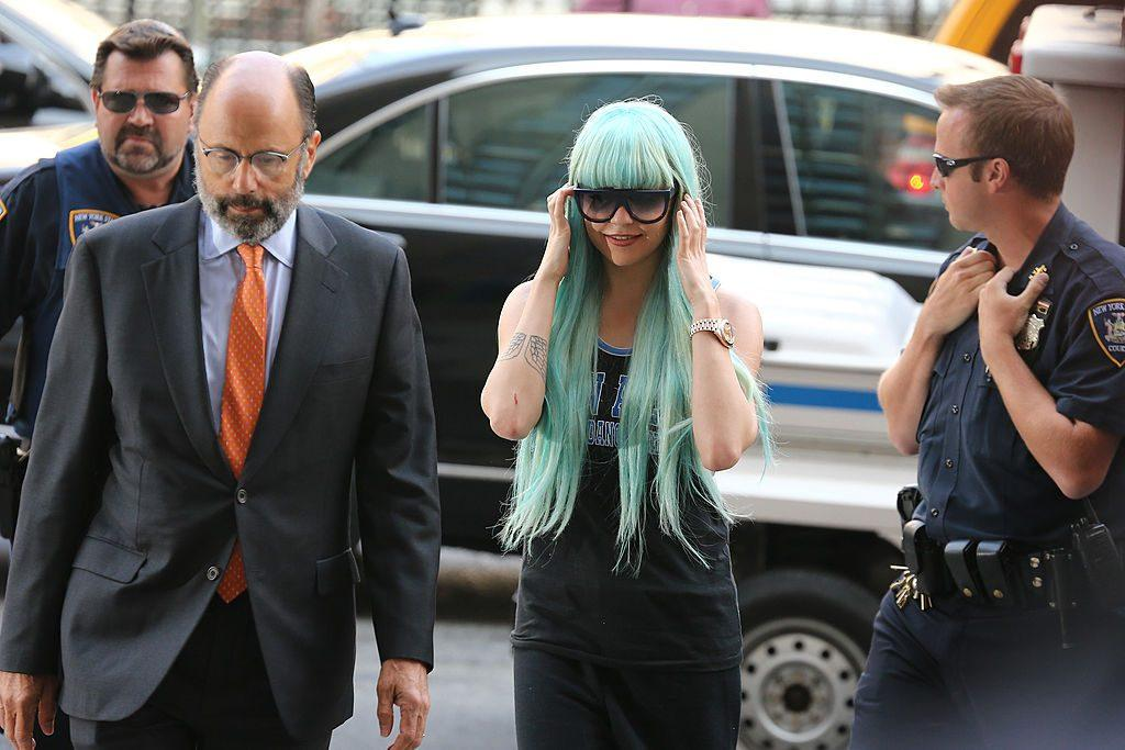 Amanda Bynes in a blue wig and sunglasses walking in New York
