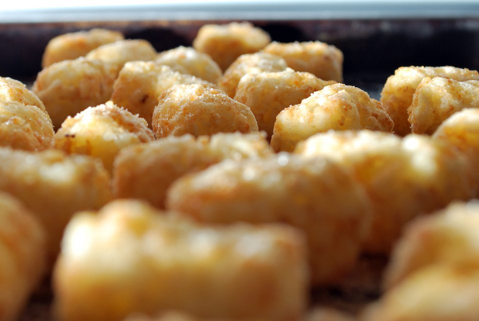 A close up of cooked tater tots