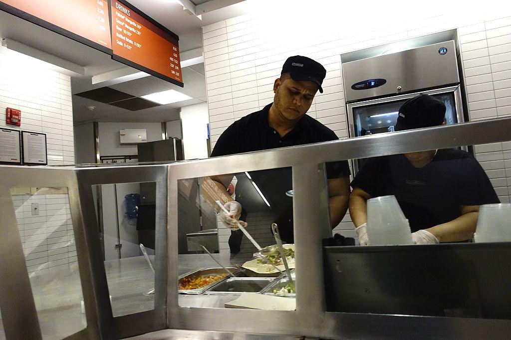 Chipotle employee prepares food in Manhattan