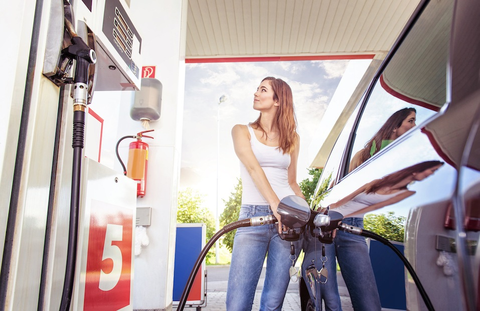 woman fills up gas tank