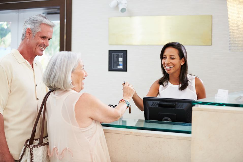 couple at hotel front desk