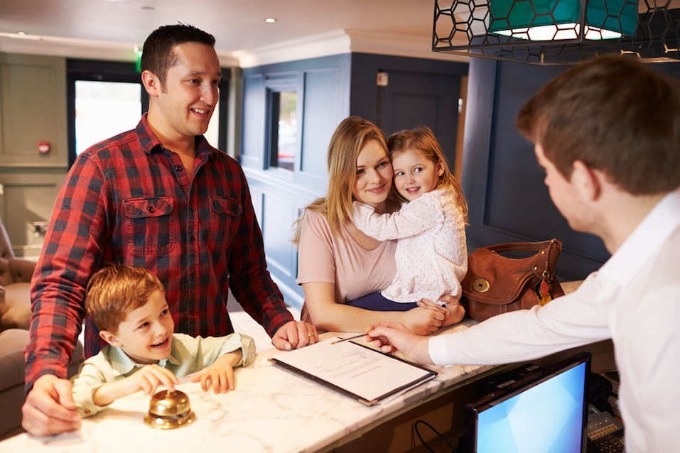 a family checks into a hotel