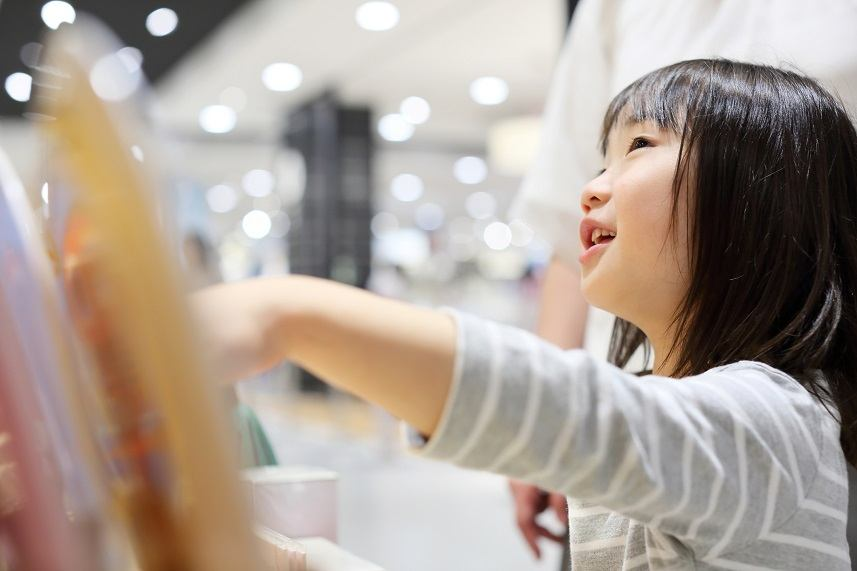 Girl doing shopping with her mother
