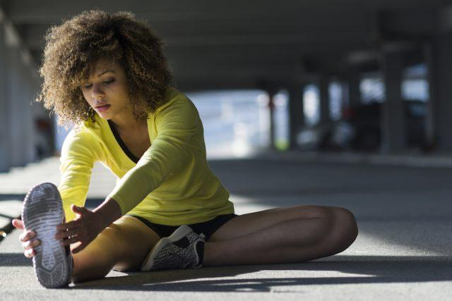 woman stretching outside