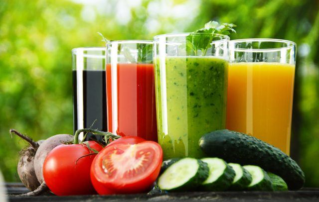 Glasses with fresh vegetable juices.