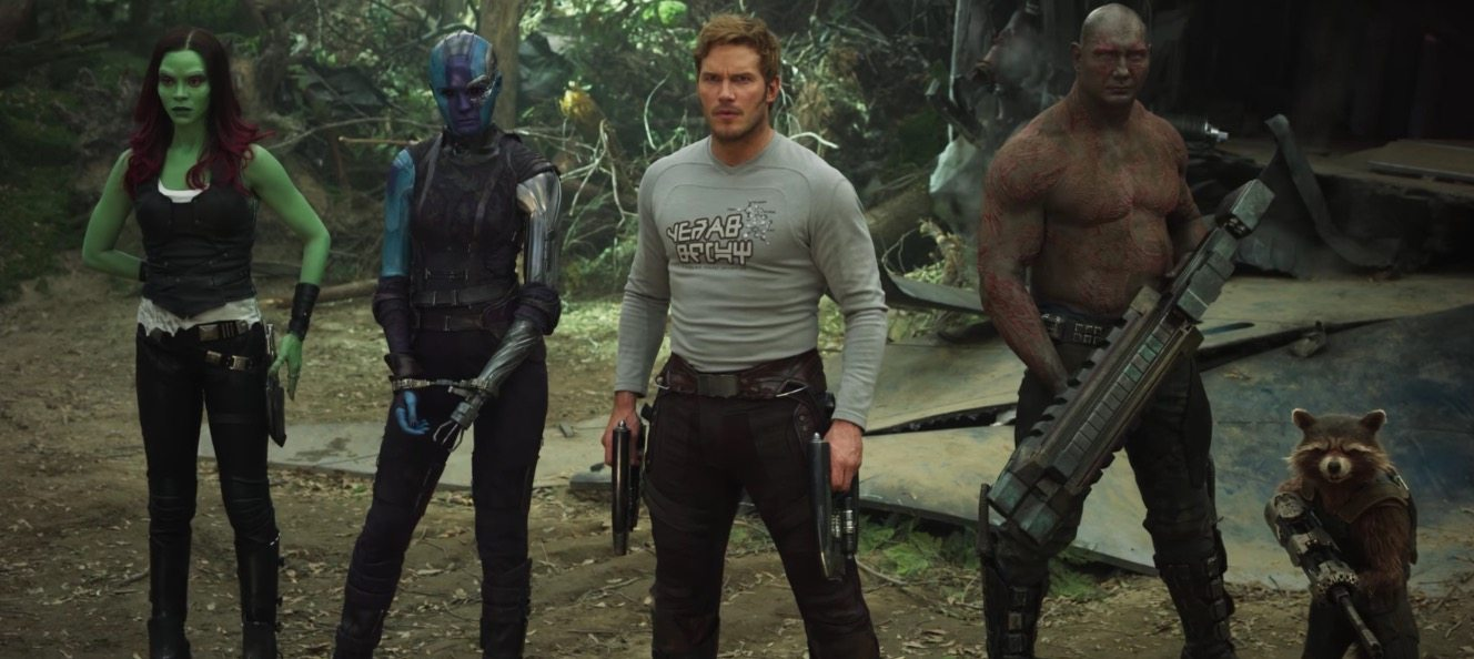 The new Guardians team stand with their weapons