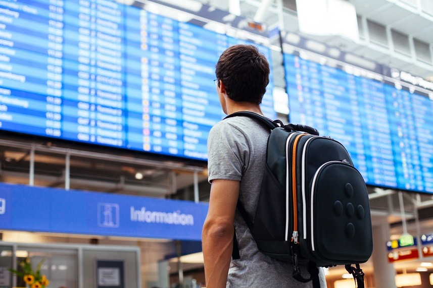 man with backpack in airport