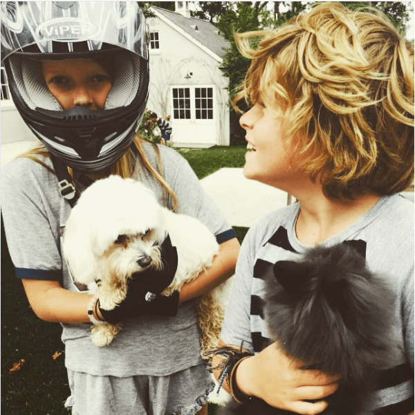 Gwyneth Paltrow's children, Apple and Moses, with the family dogs