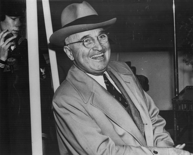 Harry S Truman President of the United States of America, laughing on board the 'Williamsburg', bound for Florida