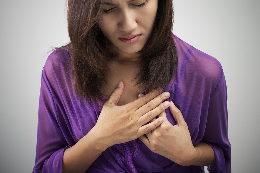 Woman having heart attack symptom