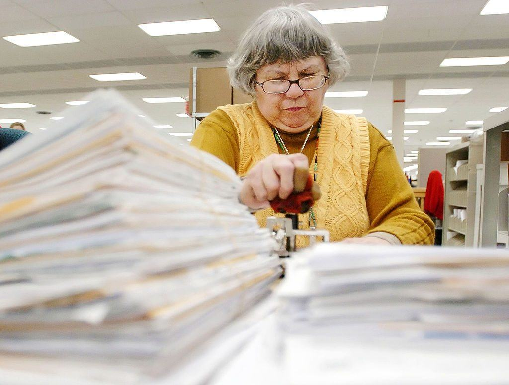 IRS worker with paperwork