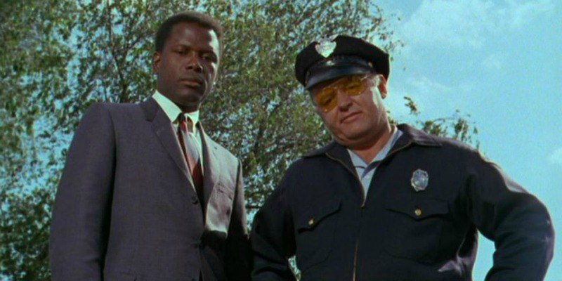 Virgil Tibbs and Gillespie in looking down at the camera In The Heat of the Night.