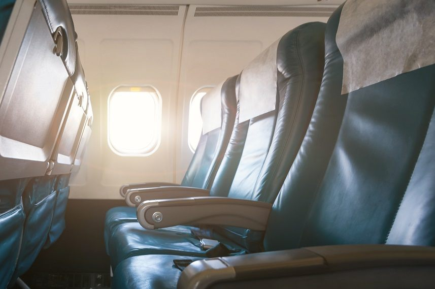 Interior of airplane with empty seats