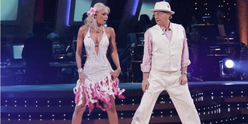 Jerry Springer and Kym Johnson dancing on Dancing With the Stars.