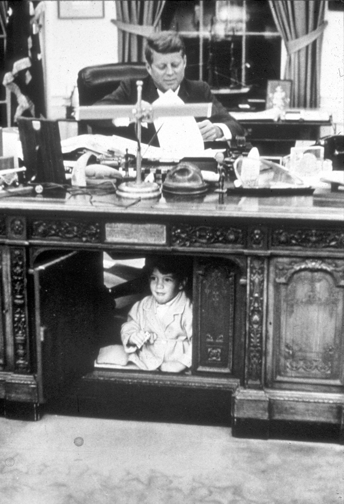 John Kennedy Jr. playing in the Oval Office at the White House