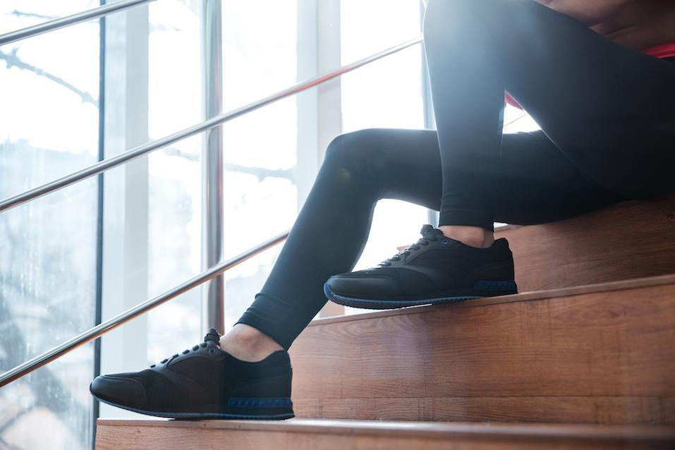 Legs in black leggings of young sportswoman s
