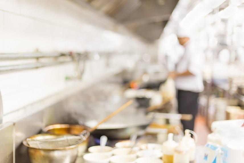 Blur chefs of a restaurant kitchen