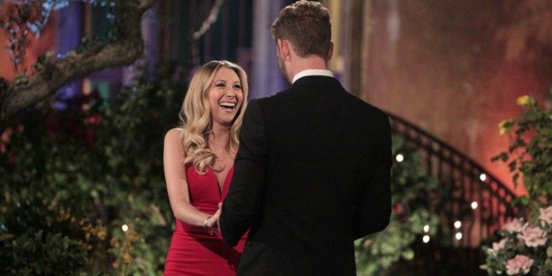 Lacey is smiling up at Nick on the first night of The Bachelor