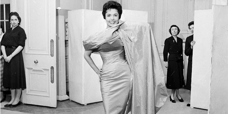 Lena Horne tries on a dress.