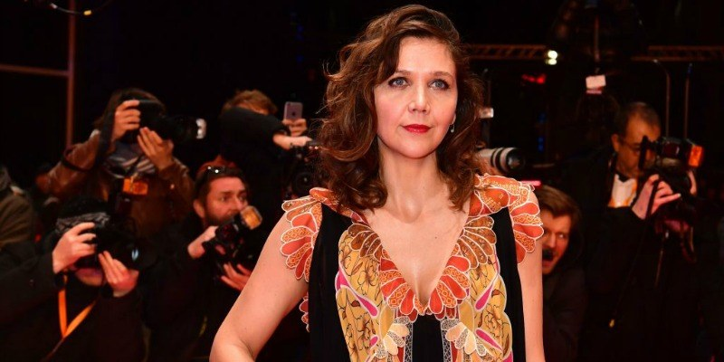 Maggie Gyllenhaal is in a dress on the red carpet.