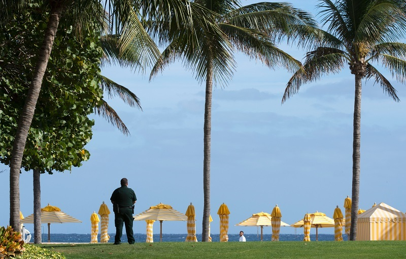 A security agent stands guard near the beach