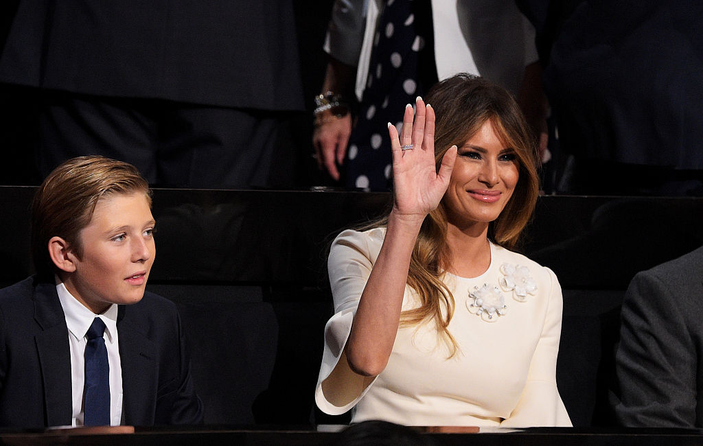 Melania Trump, wife of Republican presidential candidate Donald Trump waves during the evening session as Barron Trump