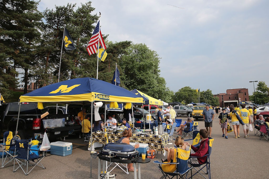 Michigan Wolverines fans at a tailgate