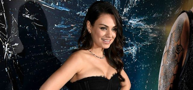 Actress Mila Kunis attends the premiere of 'Jupiter Ascending' in a black dress.