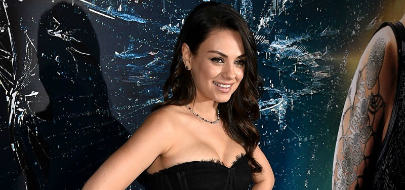 Actress Mila Kunis attends the premiere of Jupiter Ascending in a black dress.