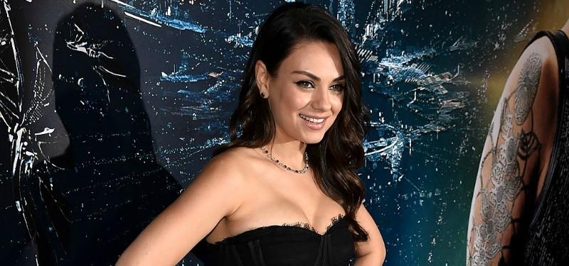 Actress Mila Kunis attends the premiere of Jupiter Ascending in a black dress.