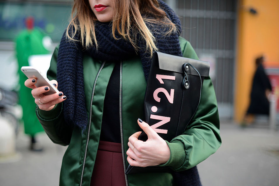 Giulia Capresi poses wearing an Acne bomber