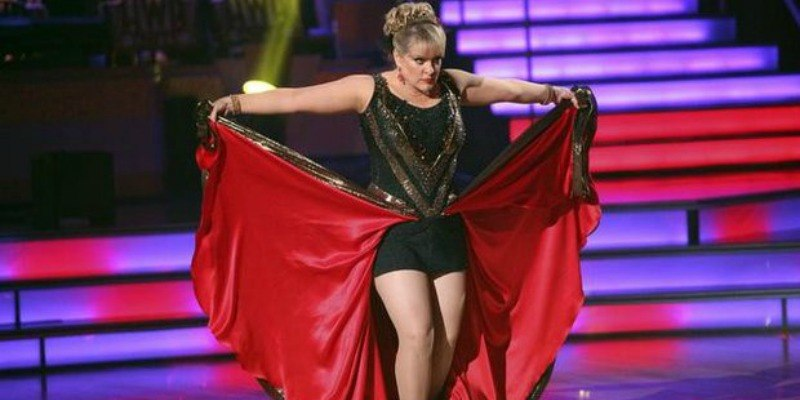 Nancy Grace dancing in a black and red dress on Dancing With the Stars.