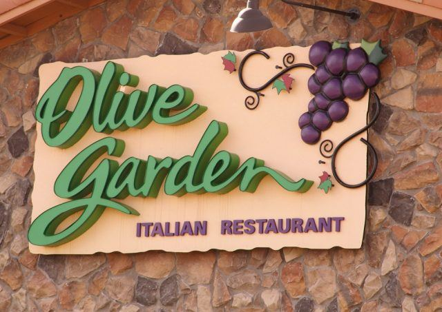The Olive Garden Sign is on the rock exterior of the building